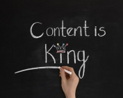 """Content is king"" handwritten on chalkboard."